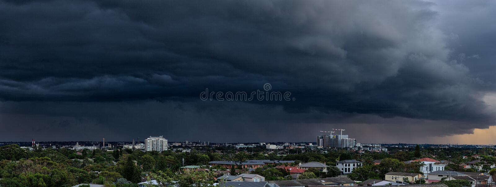 Massive storm front over Sydney, Australia. A massive rain bearing storm front closes in on a stretch of suburbia in Sydney, Australia stock photo