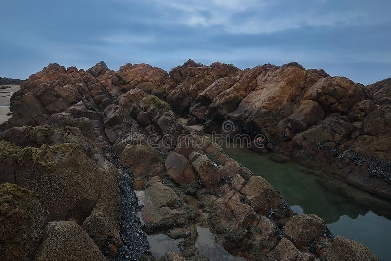 Massive, textured evidence of volcanic action. The textured rock formations at Die Punt near Mossel Bay in South Africa, is not only lovely, but also evidence of royalty free stock photography