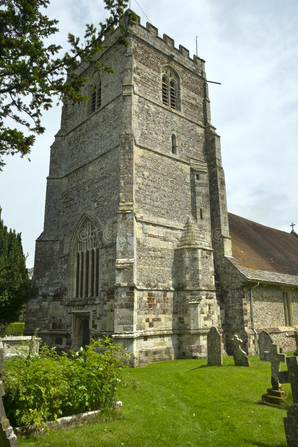 The massive 15th-century tower of the church of St Mary and St Bartholomew in rural Cranbourne. Village, Dorset, England, UK royalty free stock photo