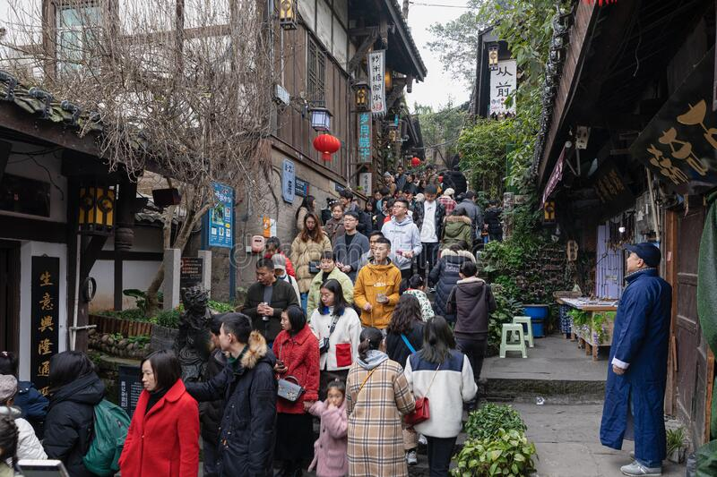 Massive tourists and local people on step street at Ciqikou royalty free stock photos