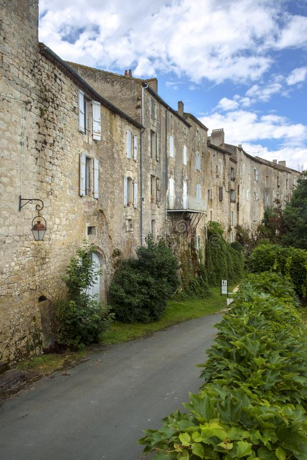 The massive walls of historic homes in Tournon d`Agenais stock image