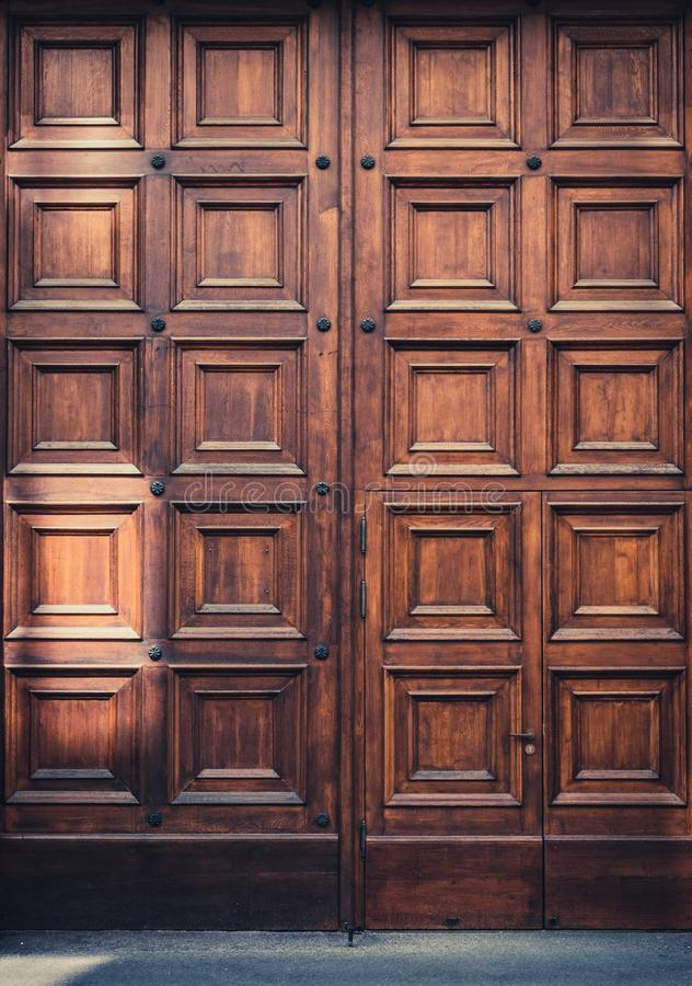 Massive wooden door entrance  - big wood gate stock photography