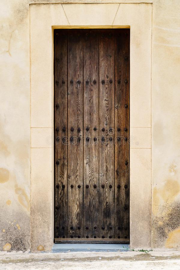 Massive wooden door in a facade of a house, church or castle stock images