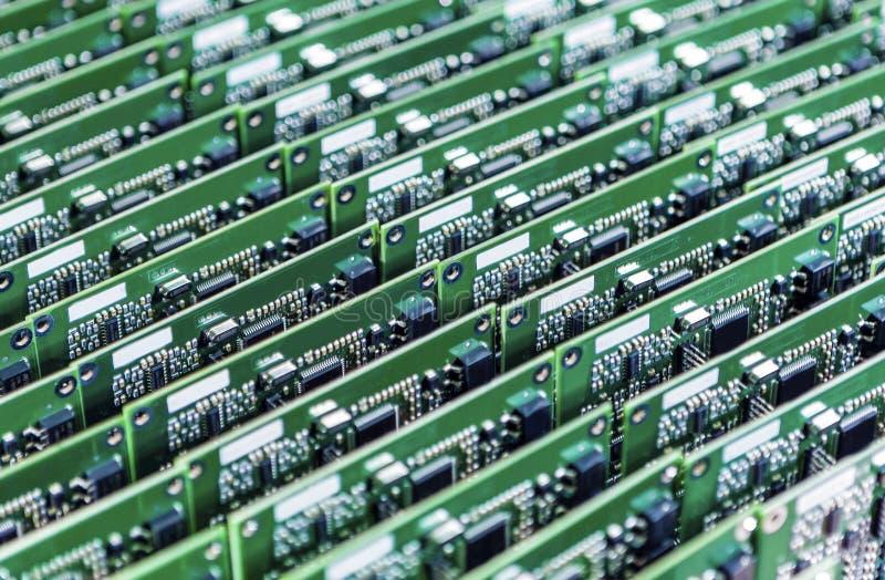 Massor av bräden för utskrivaven strömkrets med monterad och lödd Componentry royaltyfria bilder