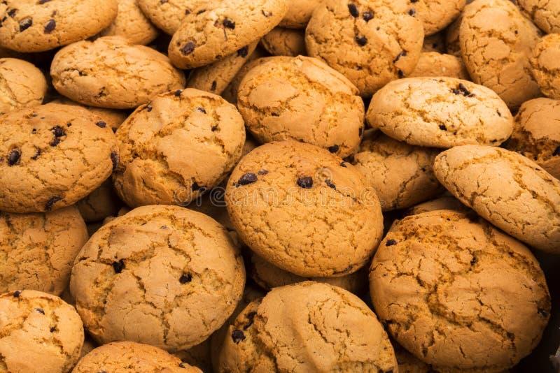 Massor av kakor och kexbakgrund arkivfoton
