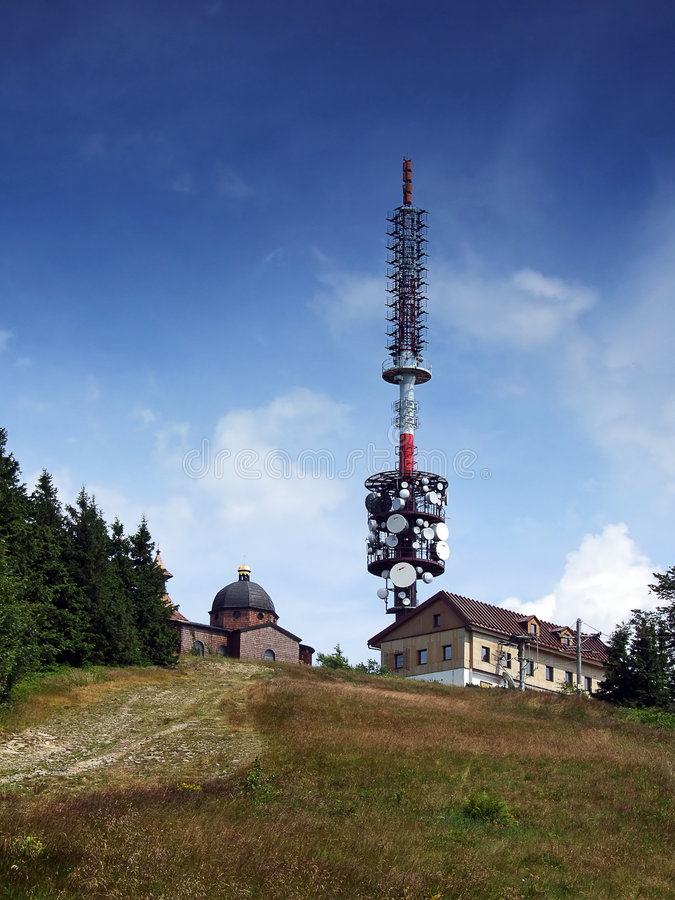 Mast. A tall mast with a dozen aerials in a hilly location royalty free stock photography