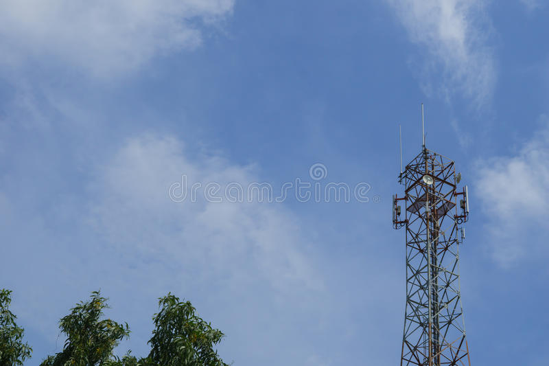 Mast cell, telecommunication tower. With Blue sky royalty free stock photography