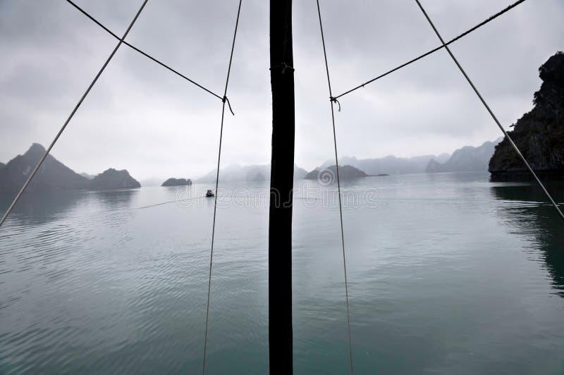 Mast and misty horizon, Halong Bay, Vietnam royalty free stock photography