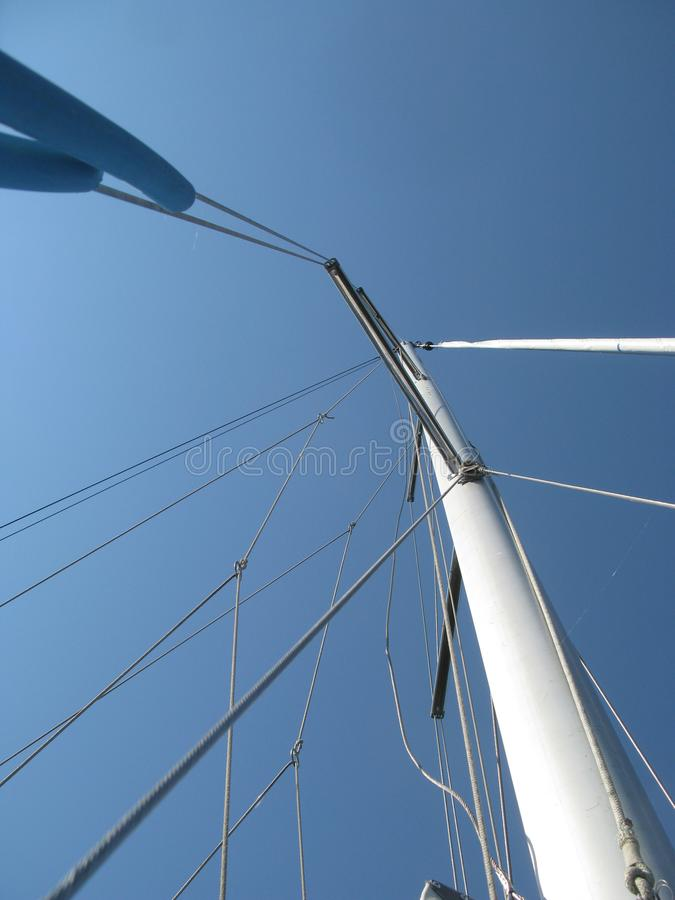 Mast and rigging of sailing boat. Mast going to the sky. royalty free stock image