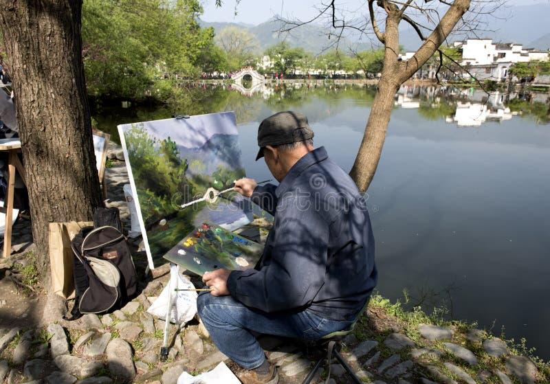 Master artist paints Hongcun, China stock photography