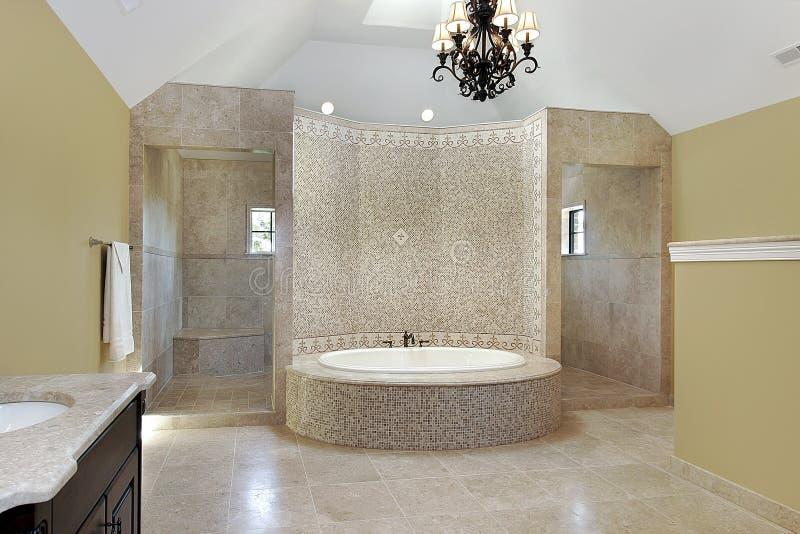 Master bath with circular bath royalty free stock photo