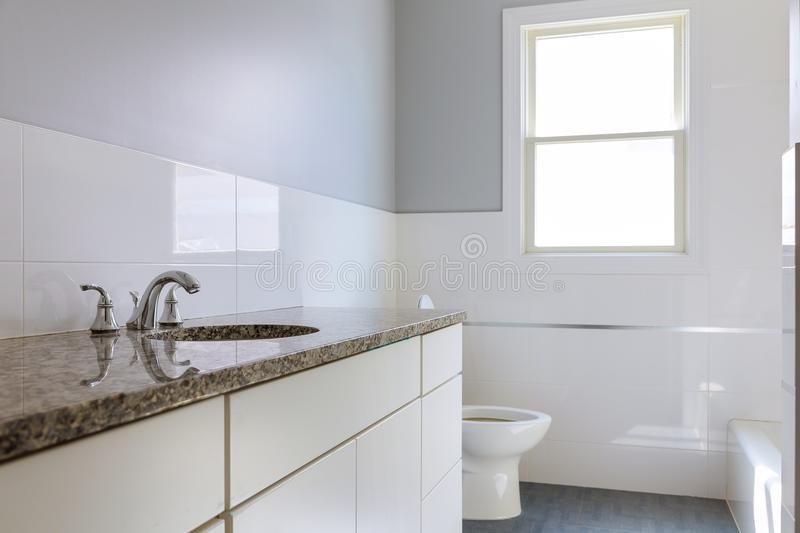 Master bath in new construction home dark wood cabinetry royalty free stock image