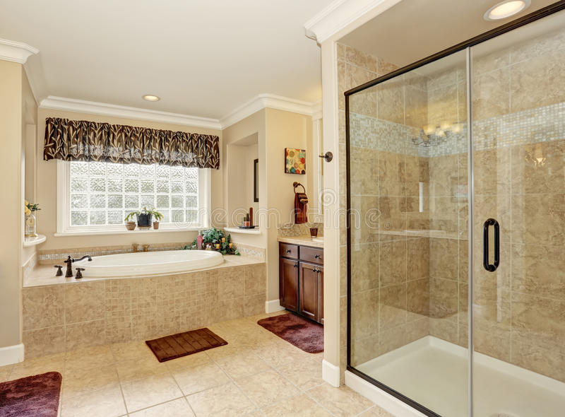 Master bathroom design with beige tile. royalty free stock images