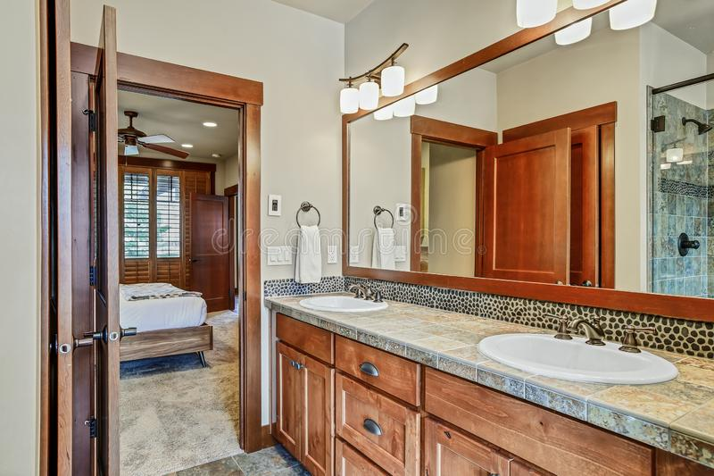 Master bathroom with double sink vanity cabinet. Master bathroom with double sink vanity cabinet and wood framed mirror. Northwest, USA stock images