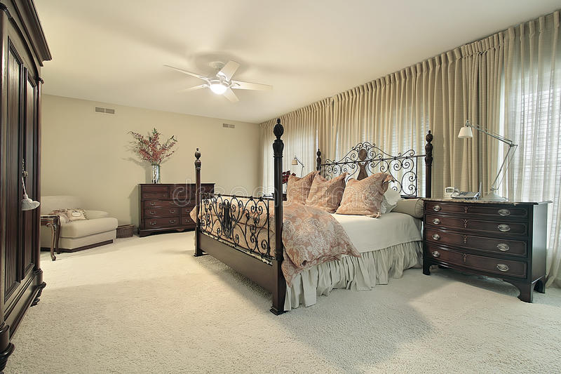 Master bedroom with dark wood furniture. Master bedroom in condominium with dark wood furniture royalty free stock photo