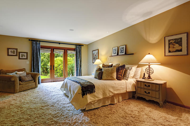 Master bedroom interior with exit to backayrd. stock photography