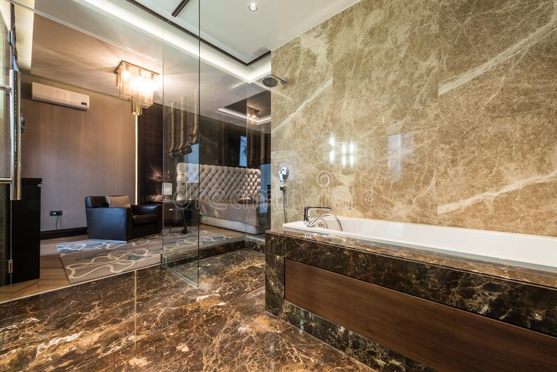 Master bedroom interior with luxury bathroom royalty free stock photography