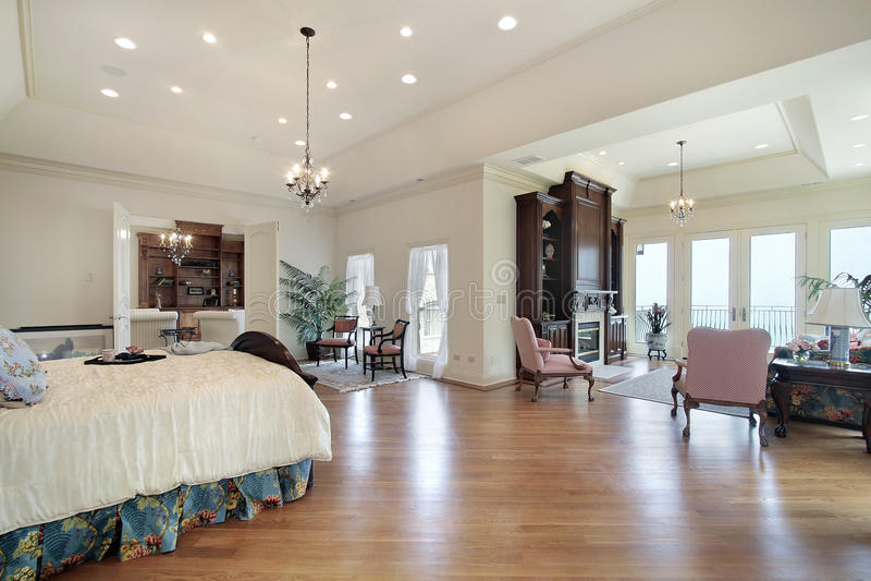 Master bedroom in luxury home stock photos