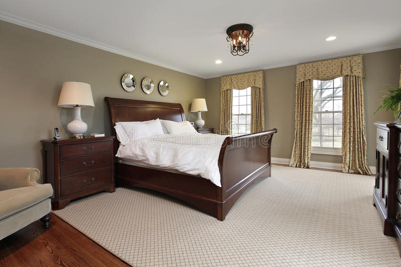 Master bedroom in luxury home stock images