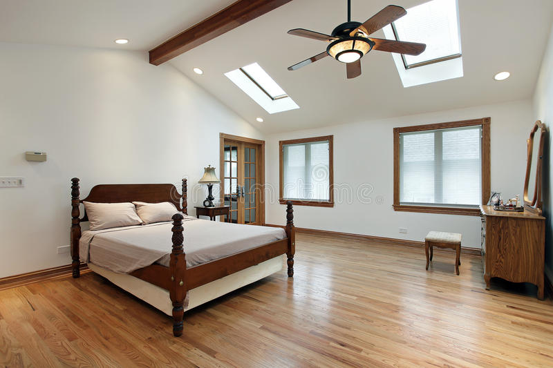 Master bedroom with skylights royalty free stock image