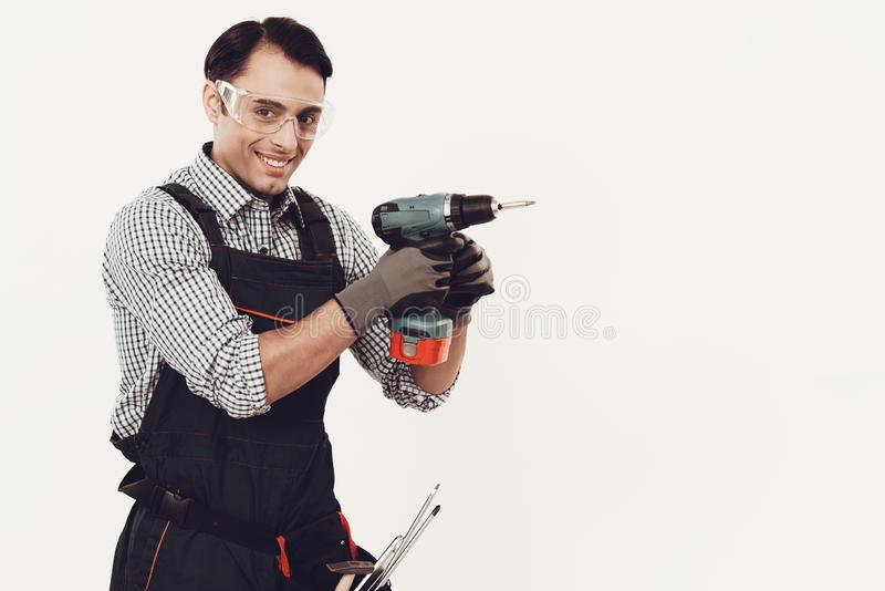 Arab Worker with Drill on White Background. stock photography