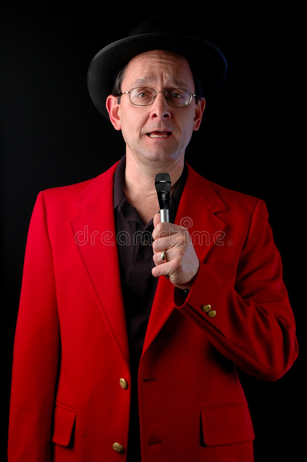 Master of Ceremonies. Talking to a microphone over a black background royalty free stock photo