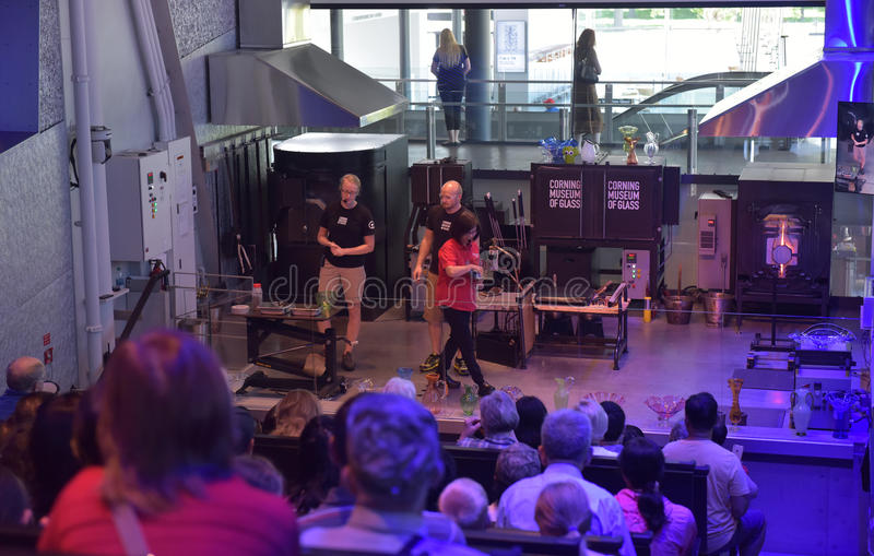 Master class glassblowers. The Corning Museum of Glass, USA royalty free stock images