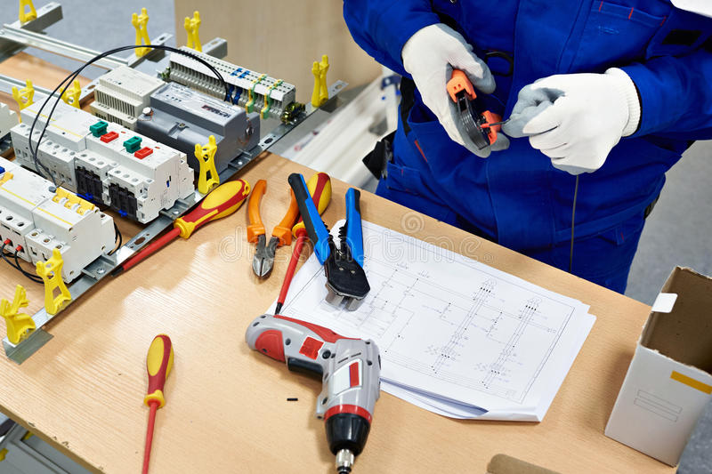 Master electrician collects electrical diagram royalty free stock photos