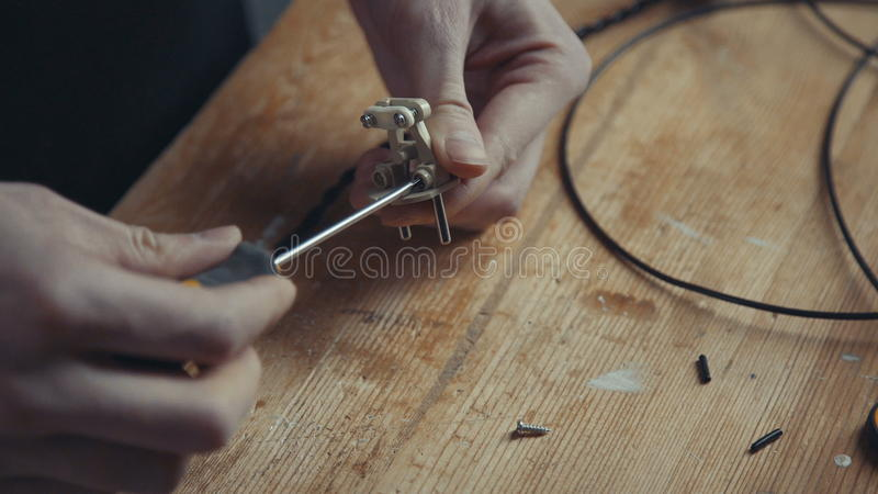 Master electrician to do an old lamp or appliance. stock photography