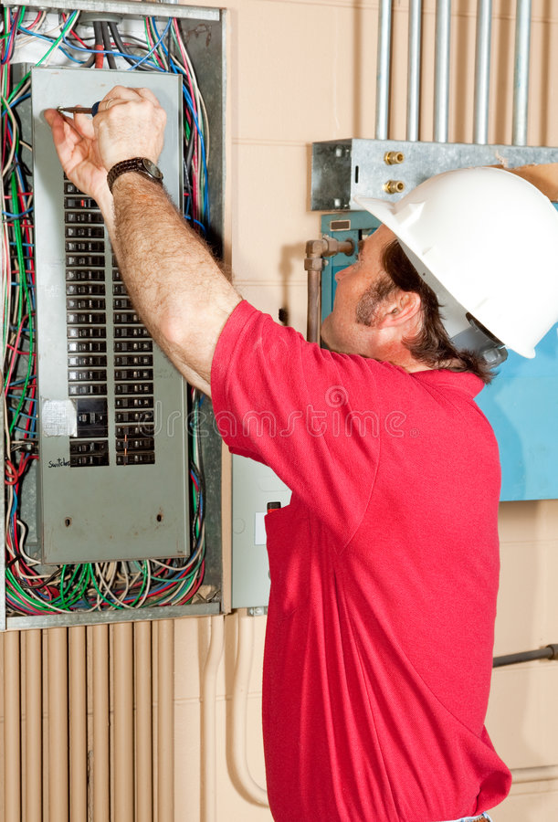 Master Electrician Working royalty free stock images