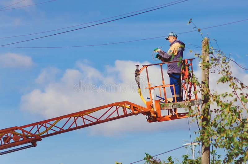 Master electrician works on the pole. royalty free stock photos