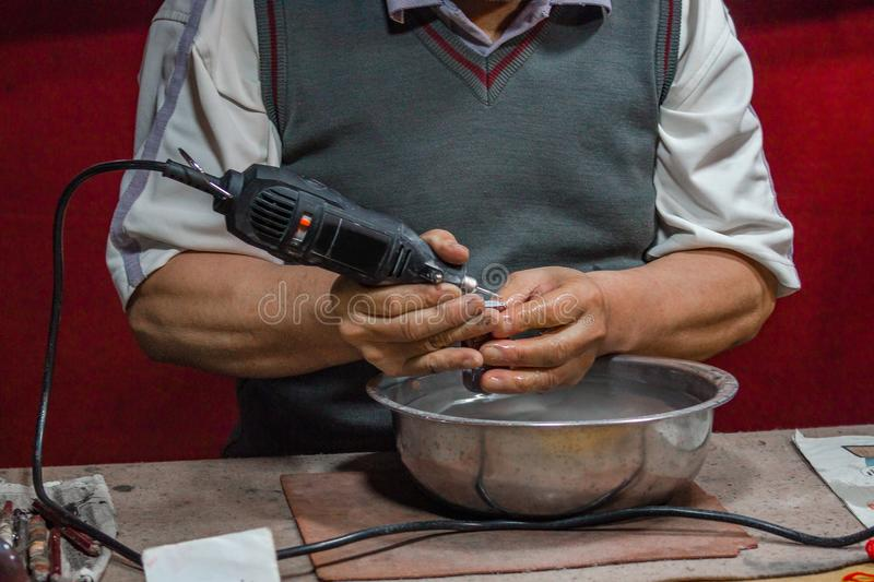 The master engraves the stone seal stock images