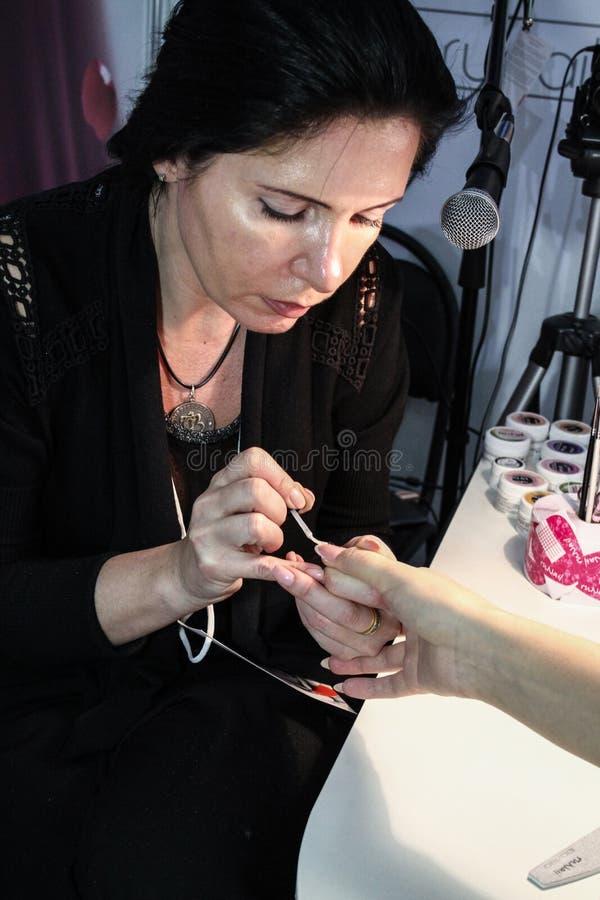 Master make nail extension stock photography