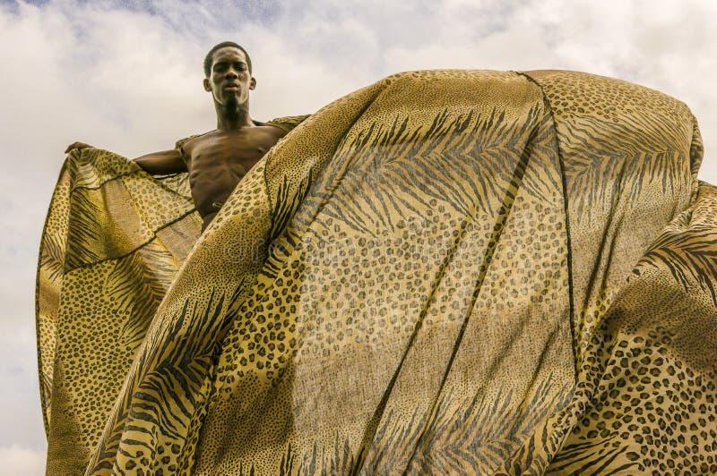 A Master Moko-Jumbie or Stiltwaker at the Queen`s Park Savannah in Port-of-Spain royalty free stock photo