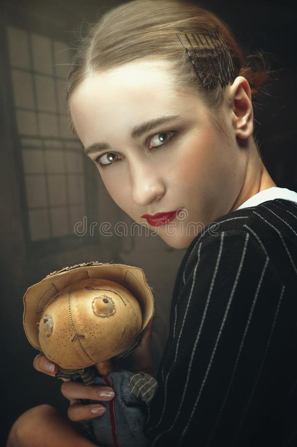 Master of Puppet. Spooky female portrait royalty free stock image