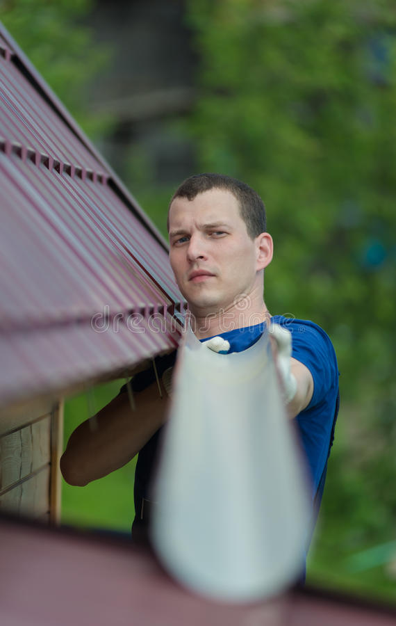 Master repairs the roof royalty free stock photo