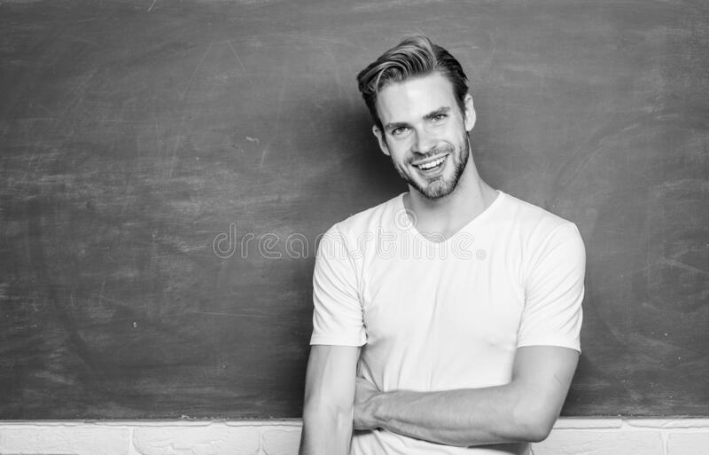 Master of simplification. Man teacher in front of chalkboard. Advantages for male elementary teacher are abundant stock photos