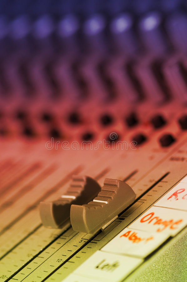 Master Volume control on sound board. With lighting royalty free stock photo