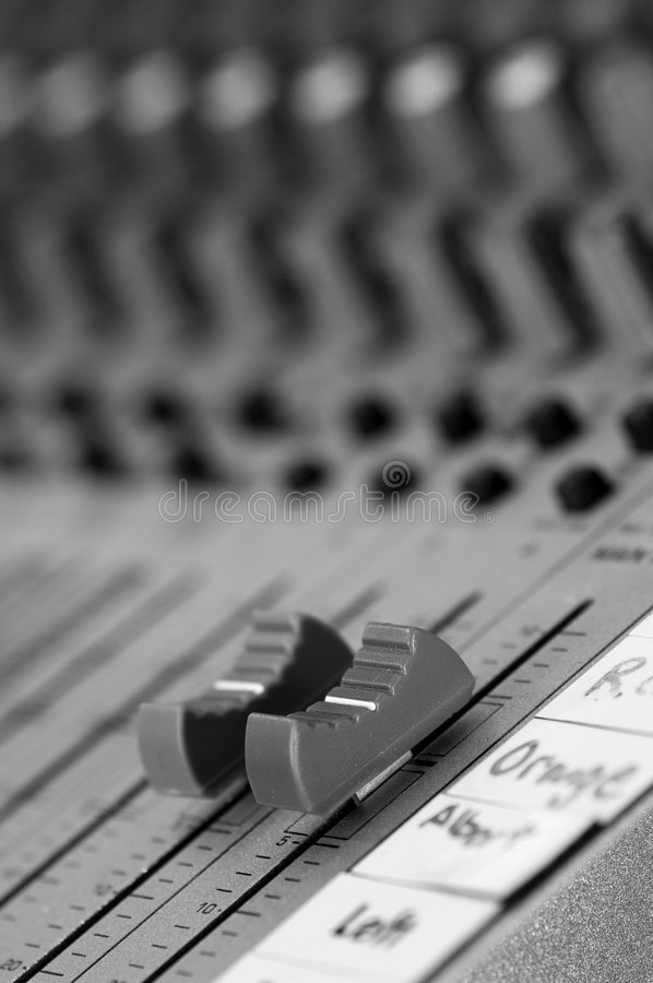 Master Volume control on sound board. Black and white royalty free stock photo