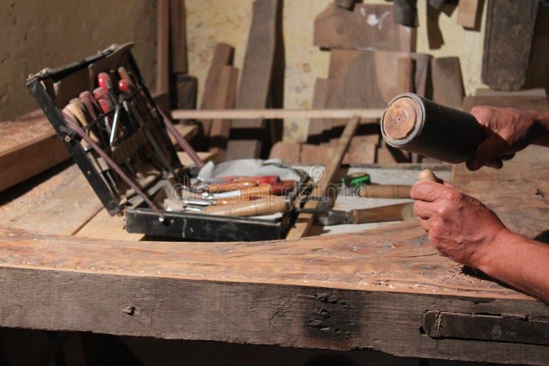Craftsman carving wood