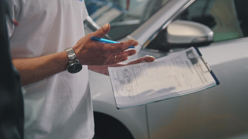 Master and worker checking car - garage auto service - small business stock photo