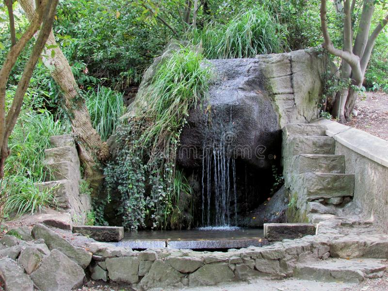 Vorontsov Palace In Alupka Crimea at the foot of Mount Aipetri. A masterpiece of landscape gardening art - Alupka Park. Small waterfall with stone steps in the royalty free stock photos