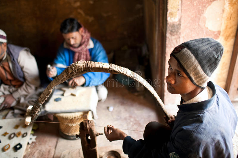 Masters of cutting marble in Agra, India royalty free stock photography