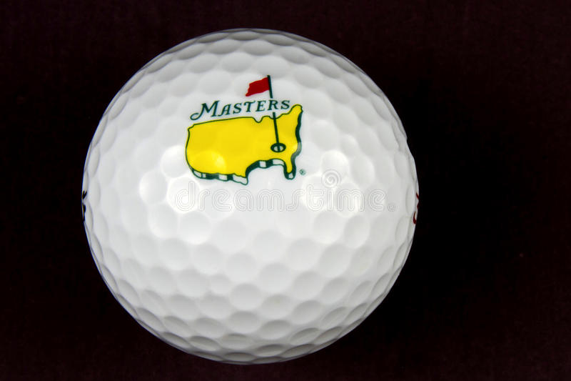 The Masters Tournament Golf Ball. The Masters Tournament logo on a golf ball with black background royalty free stock image
