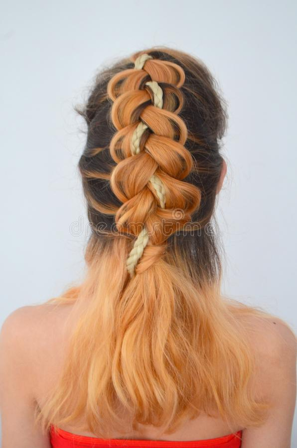 Mastery of weaving from hair with long length of hair stock photography