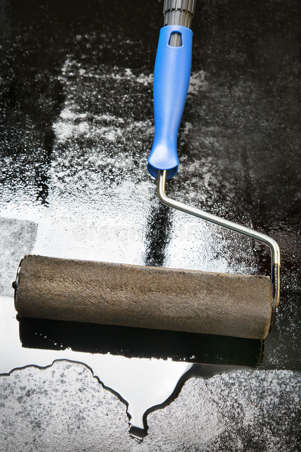 Mastic asphalt coating using a paint roller royalty free stock images