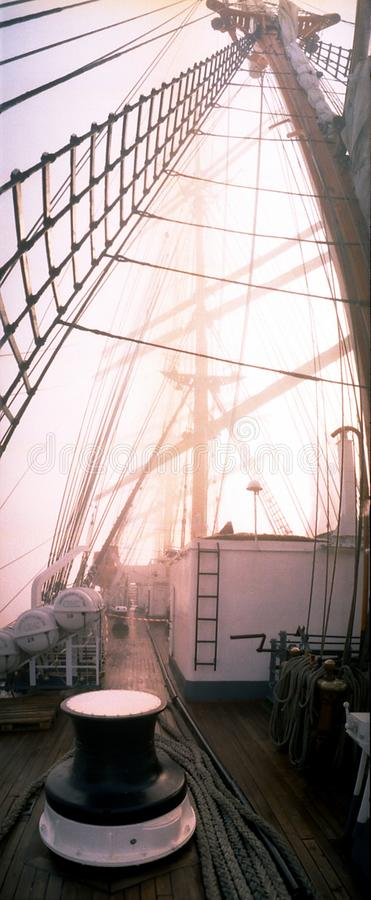 Aboard four-masted barque tall ship drifting in dense fog amidst northern Atlantic ocean. royalty free stock photo