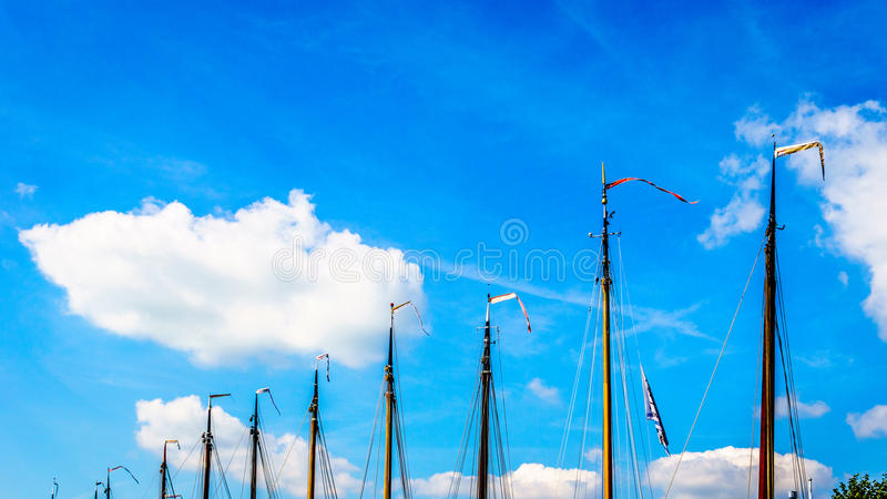 Masts with Flags on Historic Botter Boats in the Harbor of Bunschoten-Spakenburg. In the Netherlands stock image