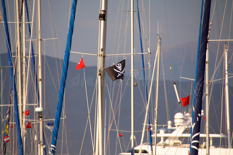 Masts with Jolly Roger on one of them, Turkey. Masts with Jolly Roger on one of them royalty free stock image