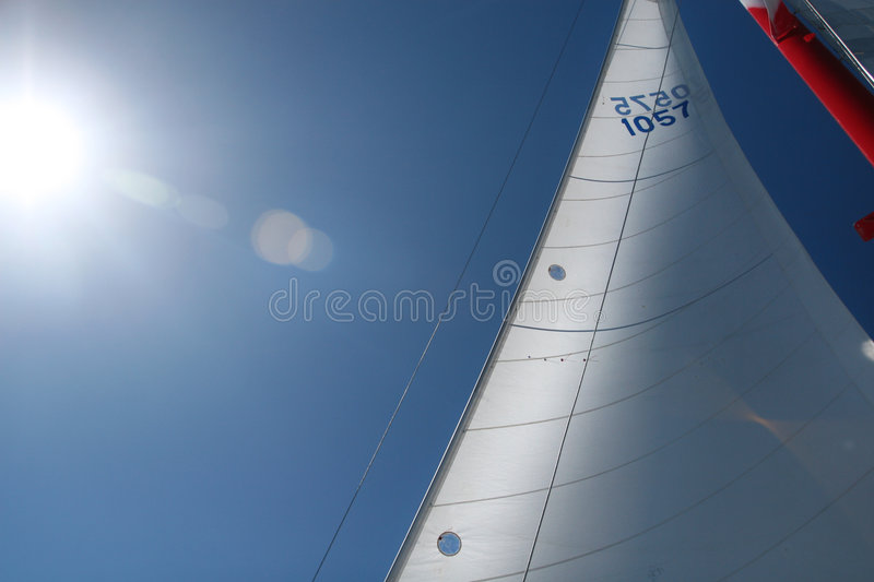 Masts and Sails on a Boat, Ship, Sun flare stock image